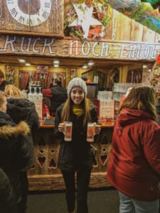 Glühwein is a common German Christmas tradition and is bought at wooden stands like this in souvenir glasses.