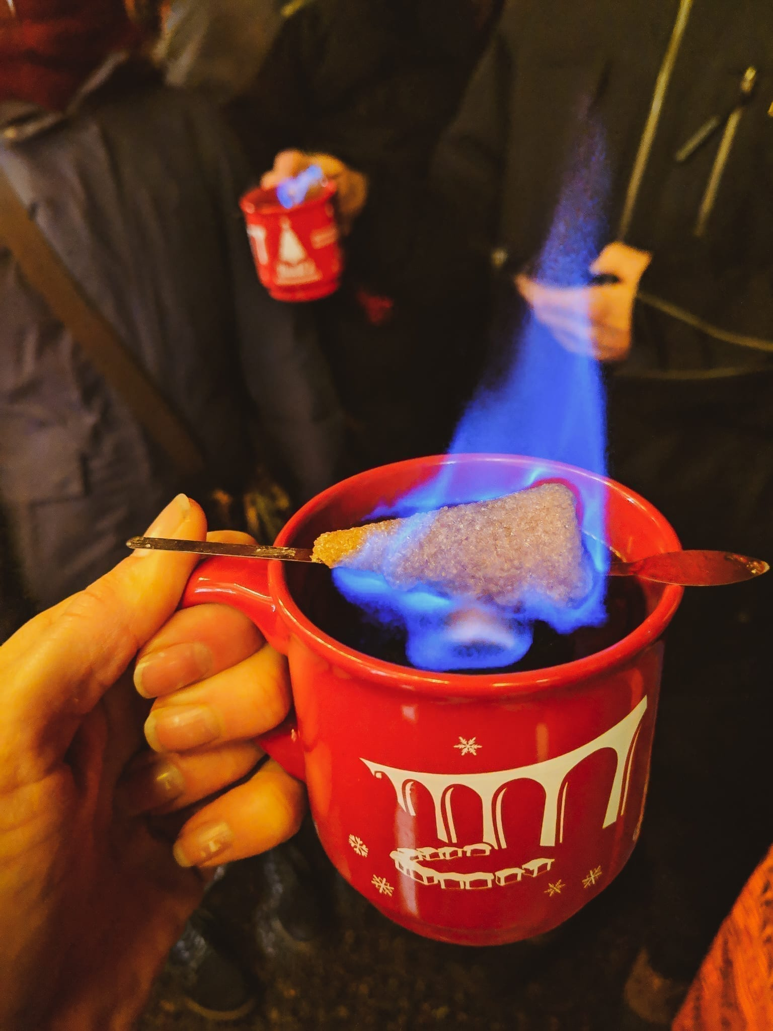 Feuerzangenbowle, flaming Glühwein at a famous German Christmas Market.