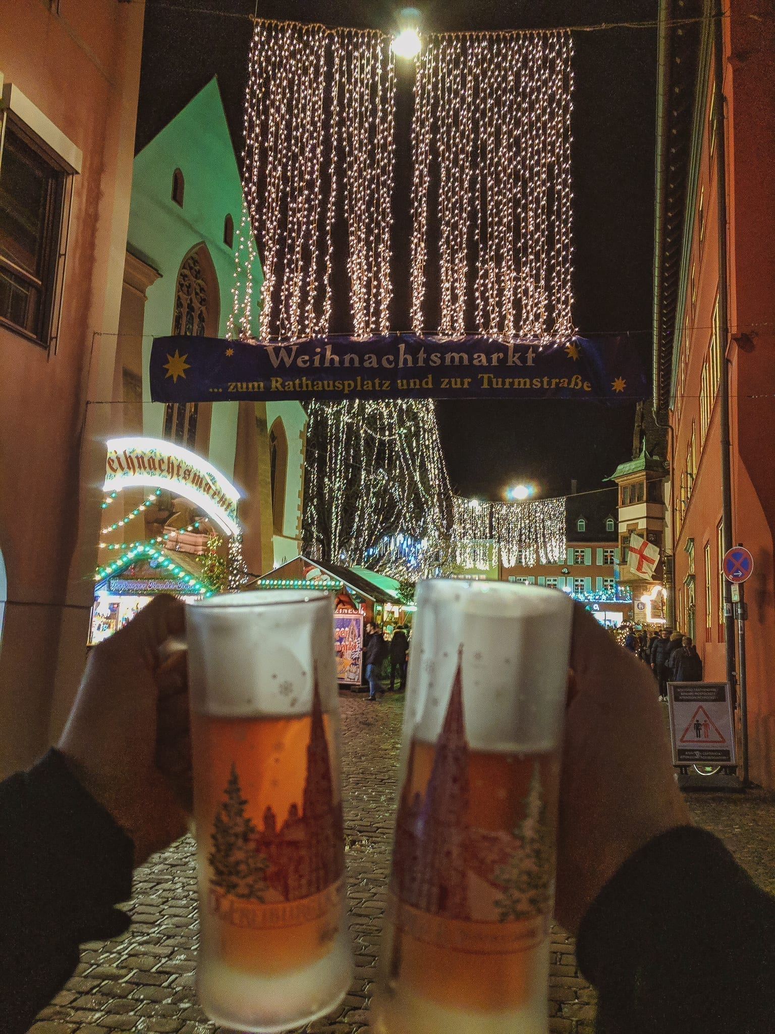 Glühwein (mulled wine) looking onto a famous German Christmas Market.